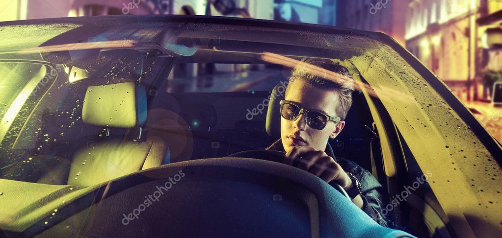 Tired young guy driving a car