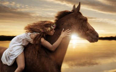Pretty lady riding a horse by gallop