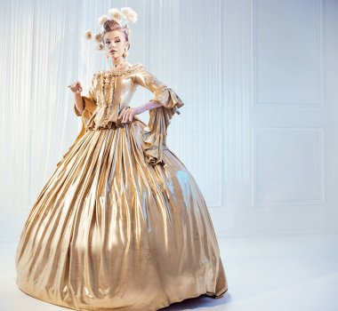 Portrait of a noble woman wearing golden victorian gown