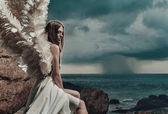 Fotografie Traurige Engel Blick auf die Occéan