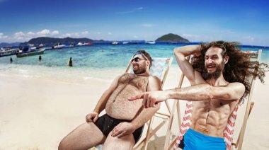 Two funny friends taking a sunbath