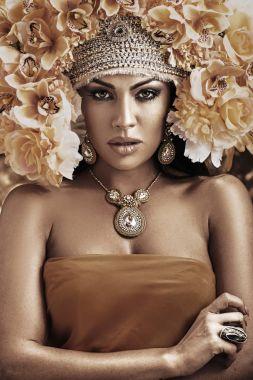 Portrait of a pretty woman wearing a flower hat