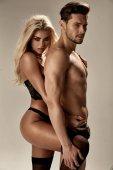 Fotografie Sensual woman hugging her handsome, muscular boyfriend
