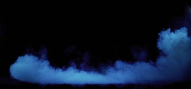 Blue smoke swirling in the grungy, dark interior