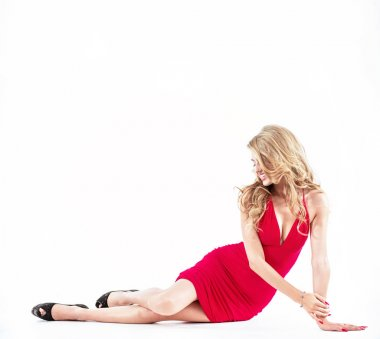 Beautiful blond lady wearing a red dress - isolated
