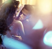 Fotografie Sensual couple in a luxurious bedroom