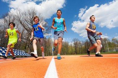 Athletics teenage boys running