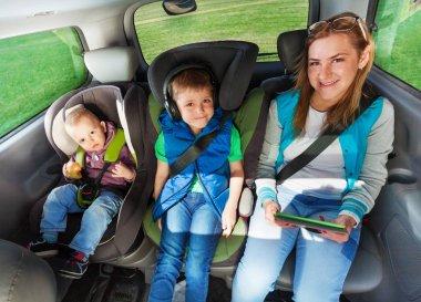 passengers on backseats of car
