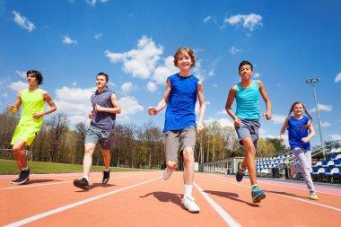 Teenage kids running on stadium