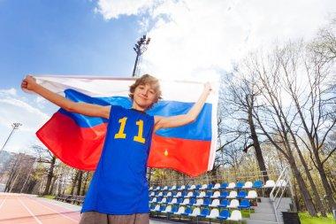 boy waving Russian flag at stadium
