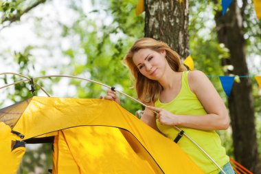 woman putting up tent