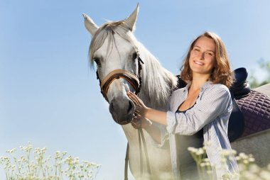 woman with beautiful white horse