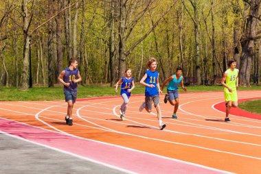 teenage athletes on stadium