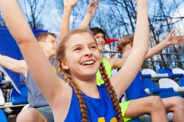 Teenage sport fans celebrating win