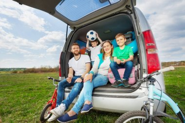 Happy family going for car trip