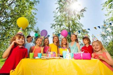 kids celebrating birthday in park
