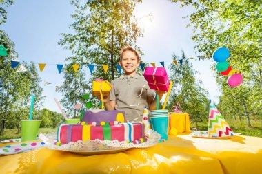 boy holding birthday gifts