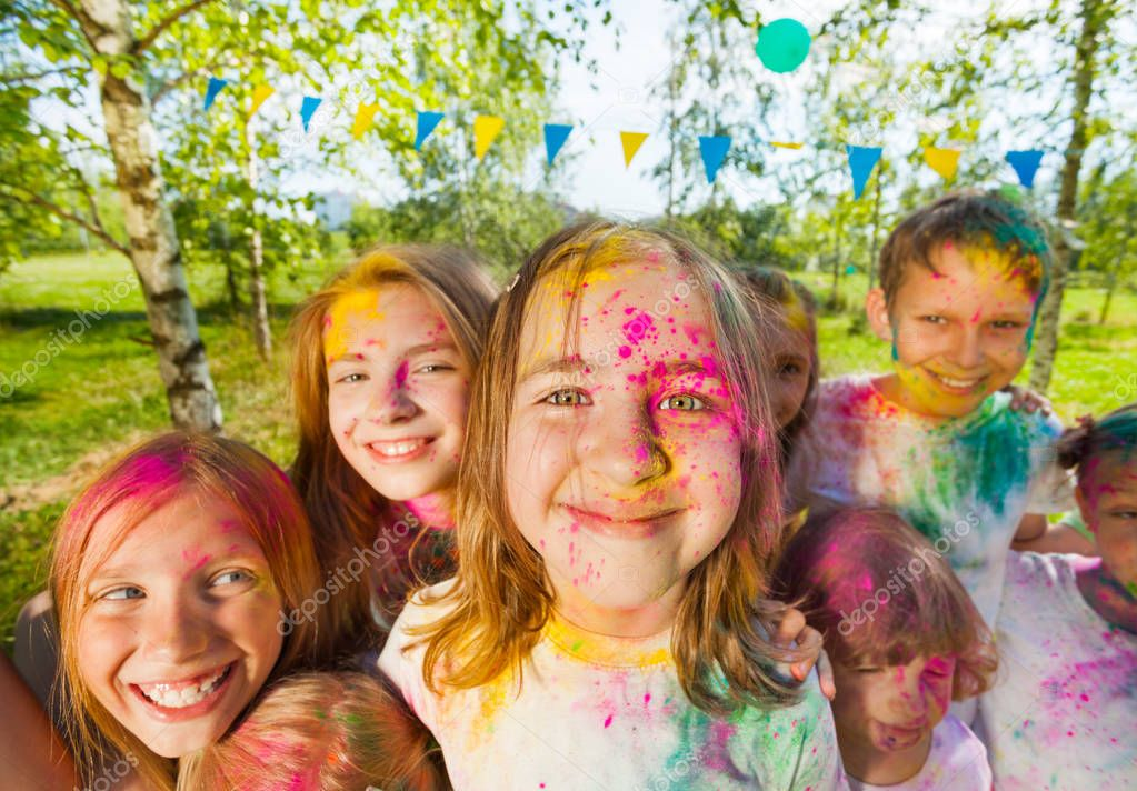 Kids having fun with colored powder