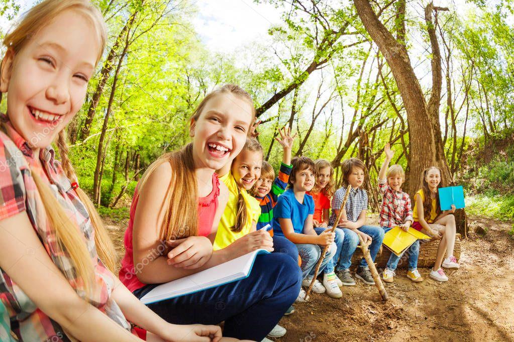 kids sitting on log