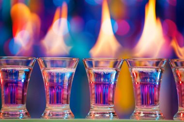 hot shot glasses standing in row