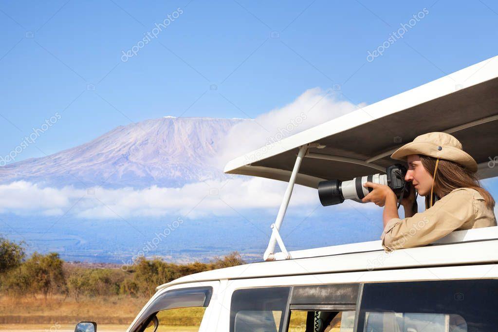 woman taking photos of Kenyan lake
