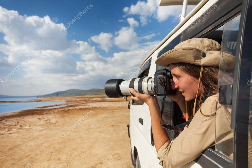 woman taking photo of Kenyan lake