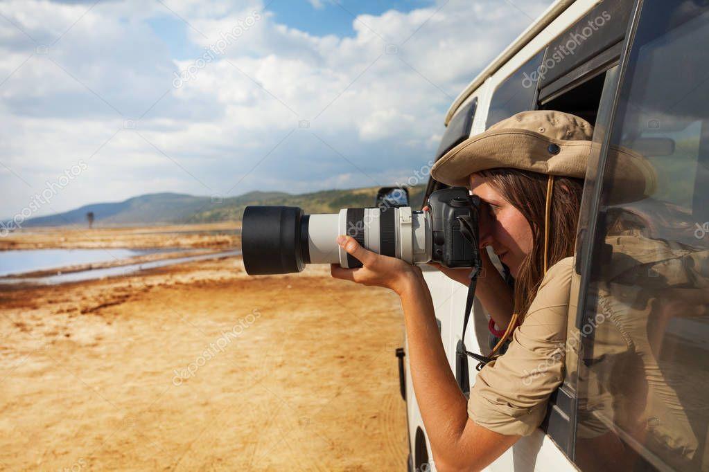 woman taking photo of lake Nakuru