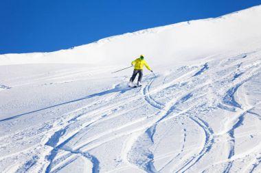Man skier hitting slopes