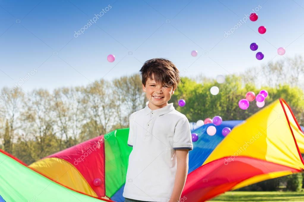 boy playing parachute and balls
