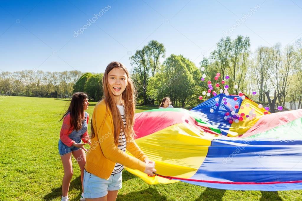 girls with rainbow parachute