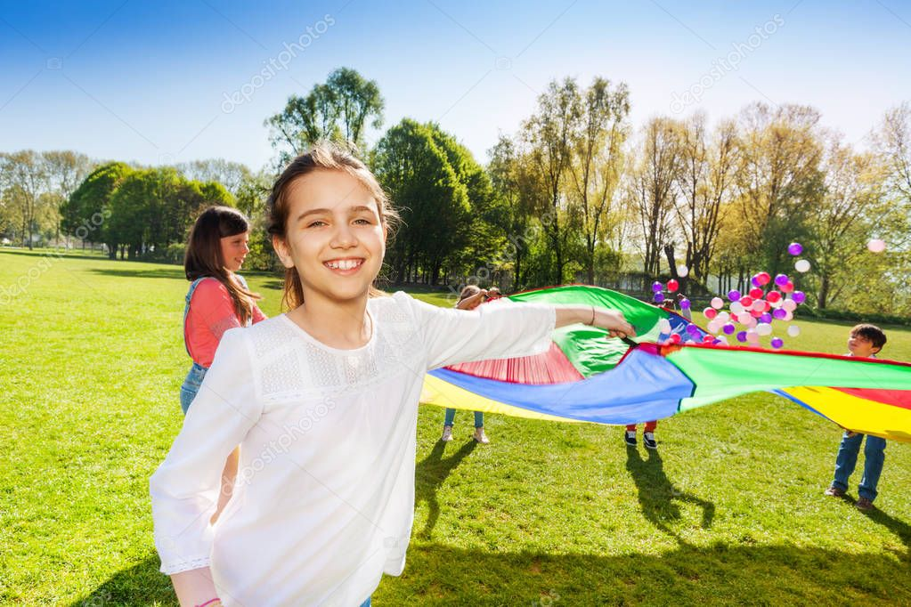 kids with rainbow parachute
