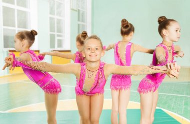 beautiful girls in pink leotards