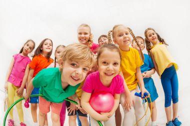 Portrait of happy kids at gym