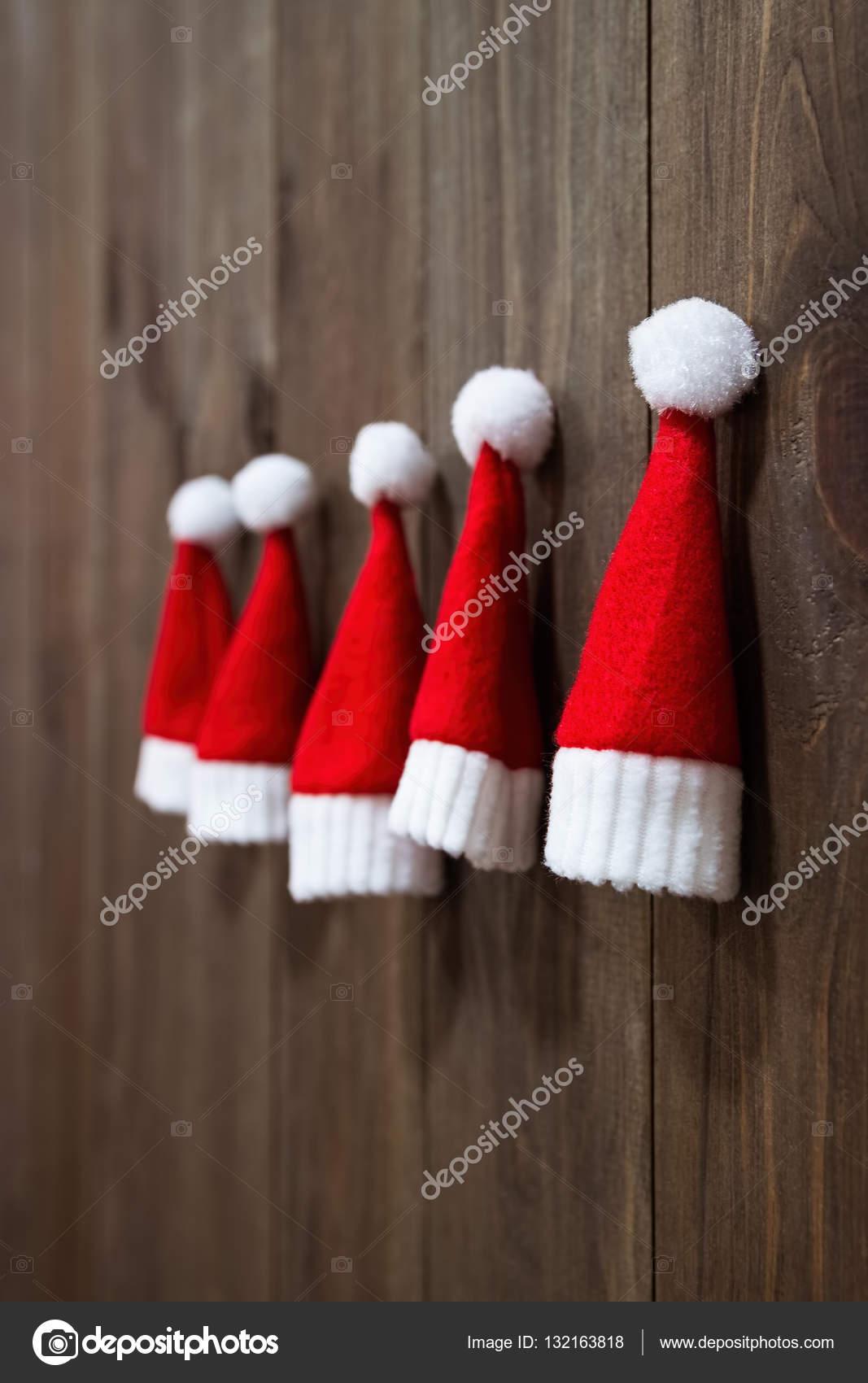 0813d790e8683 Christmas hats of Santa Claus. Christmas tree toys handmade. Christmas  ornaments. Little Santa Claus hats.– stock image