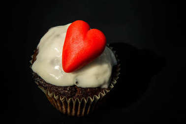 homemade chocolate cupcake decorated with marzipan red heart