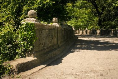 stone wall and walk-road in park of Vorontsov palace in Crimea Ukraine in springtime