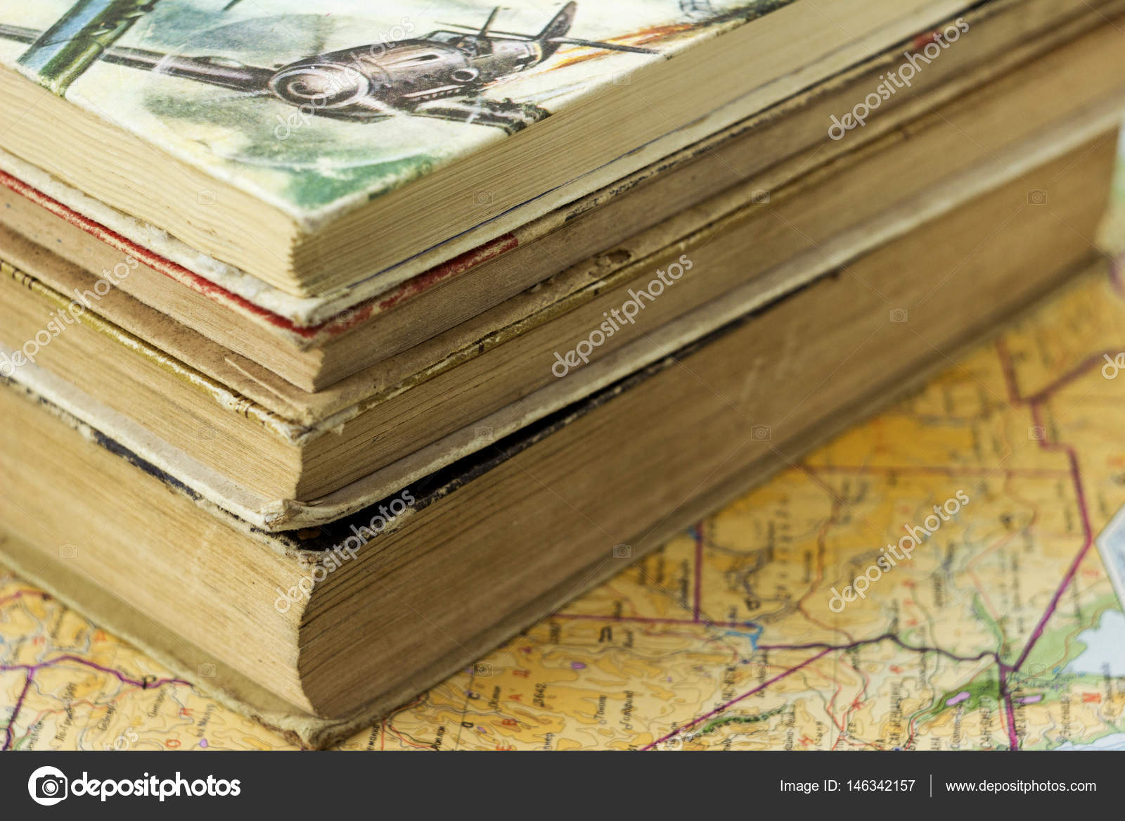 Stack of old books on the map background stock photo nikilev stack of old books on the map background stock photo gumiabroncs Gallery