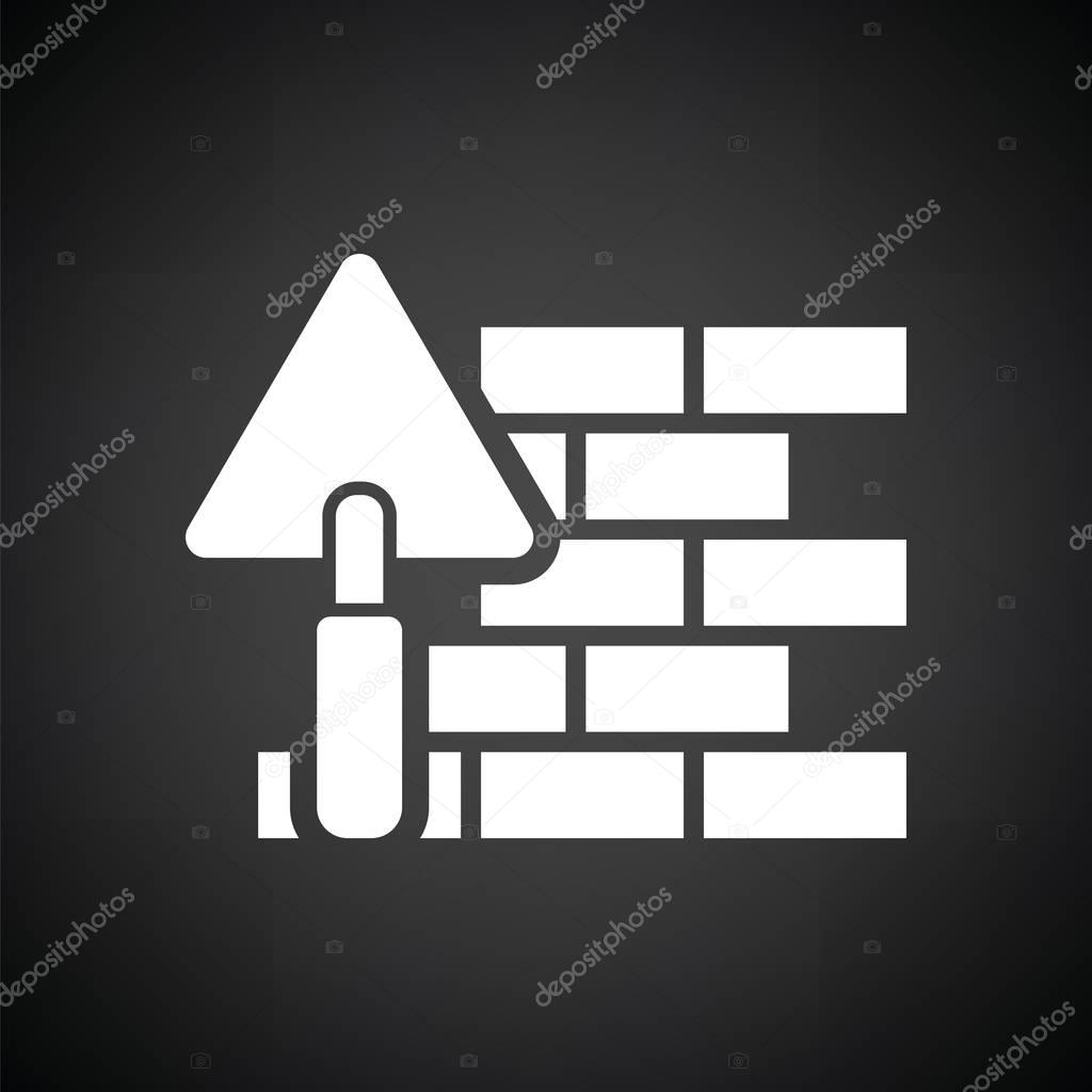 Icon of brick wall with trowel