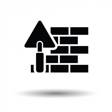 Icon of brick wall with trowel. White background with shadow design. Vector illustration. stock vector