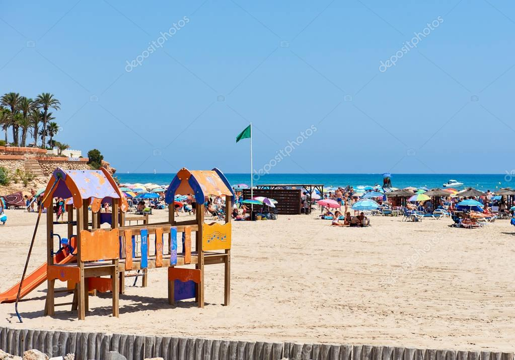 People enjoying the summer on the beach of La Zenia. Spain