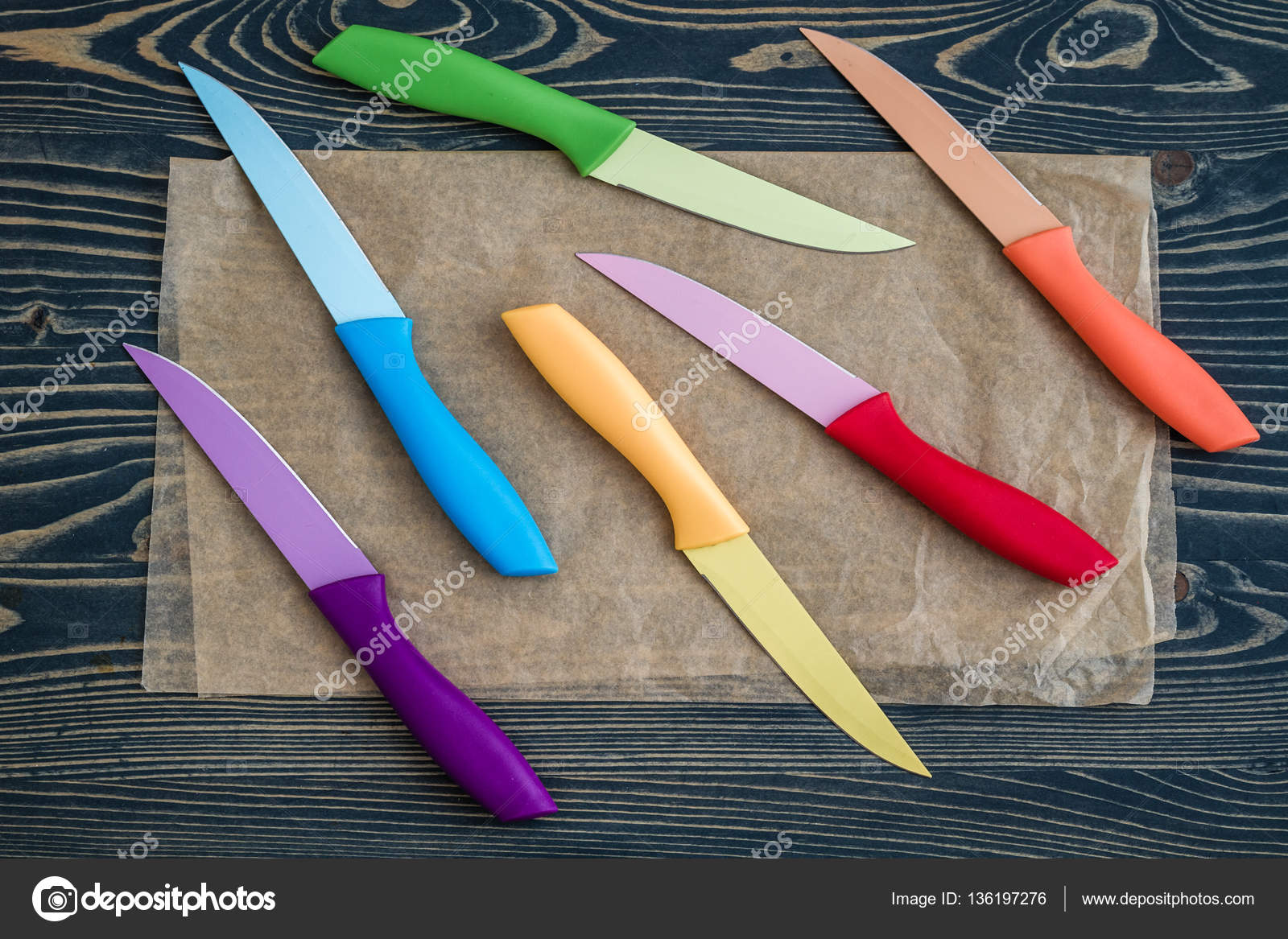 Colorful Kitchen Knives   Set Of Colorful Kitchen Knives Over Blue Wooden Background Stock