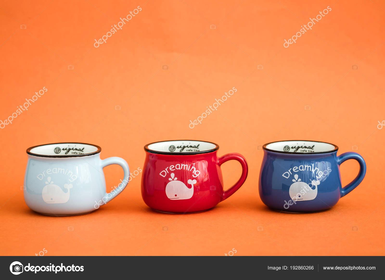 Creative Cute Coffee Mugs On Orange Background Stock Photo C Hskoken 192860266