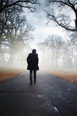 A man in a black coat