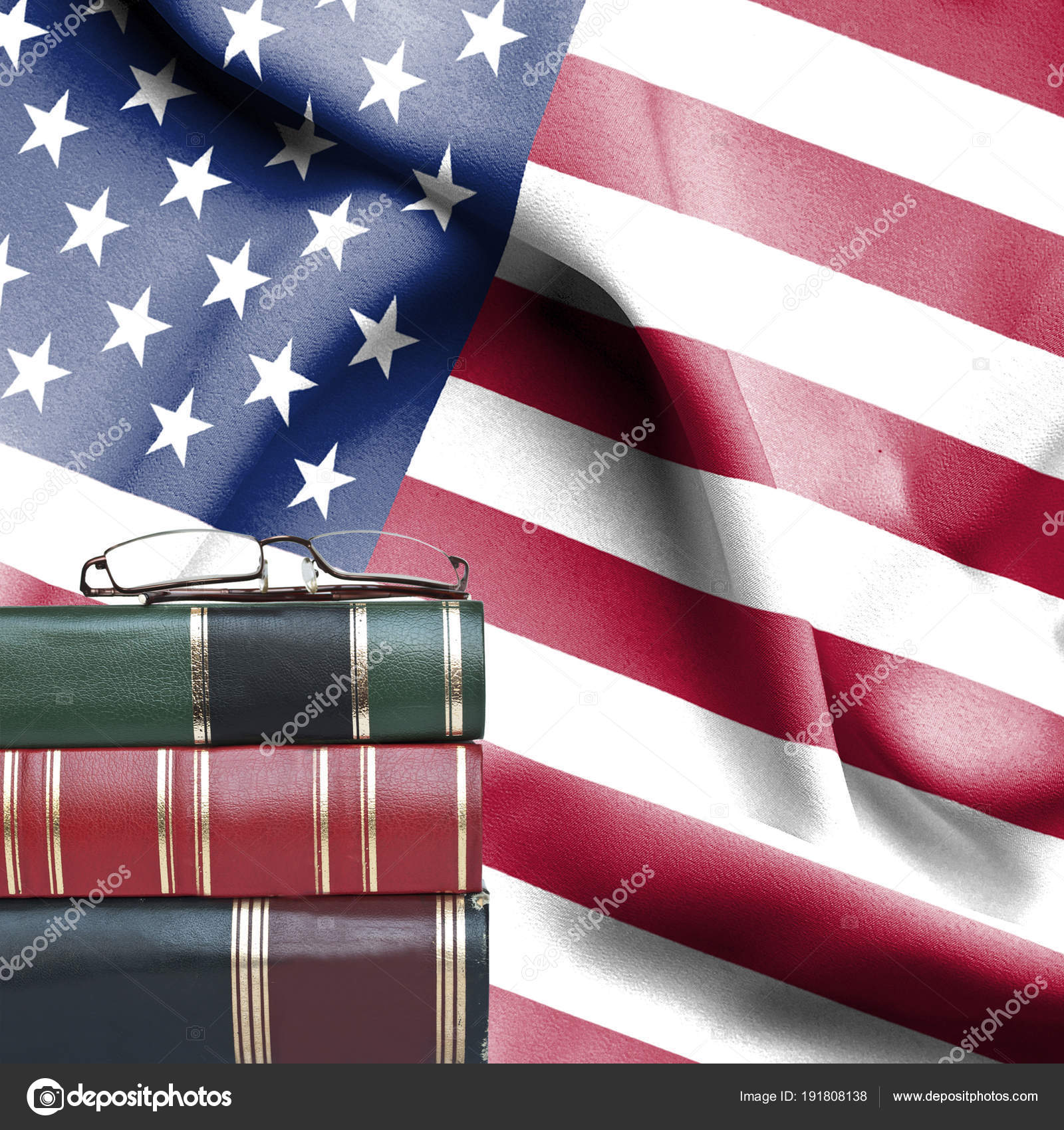 f410eee85714 Education concept - Stack of books and reading glasses against National flag  of United States of America — Photo by ...