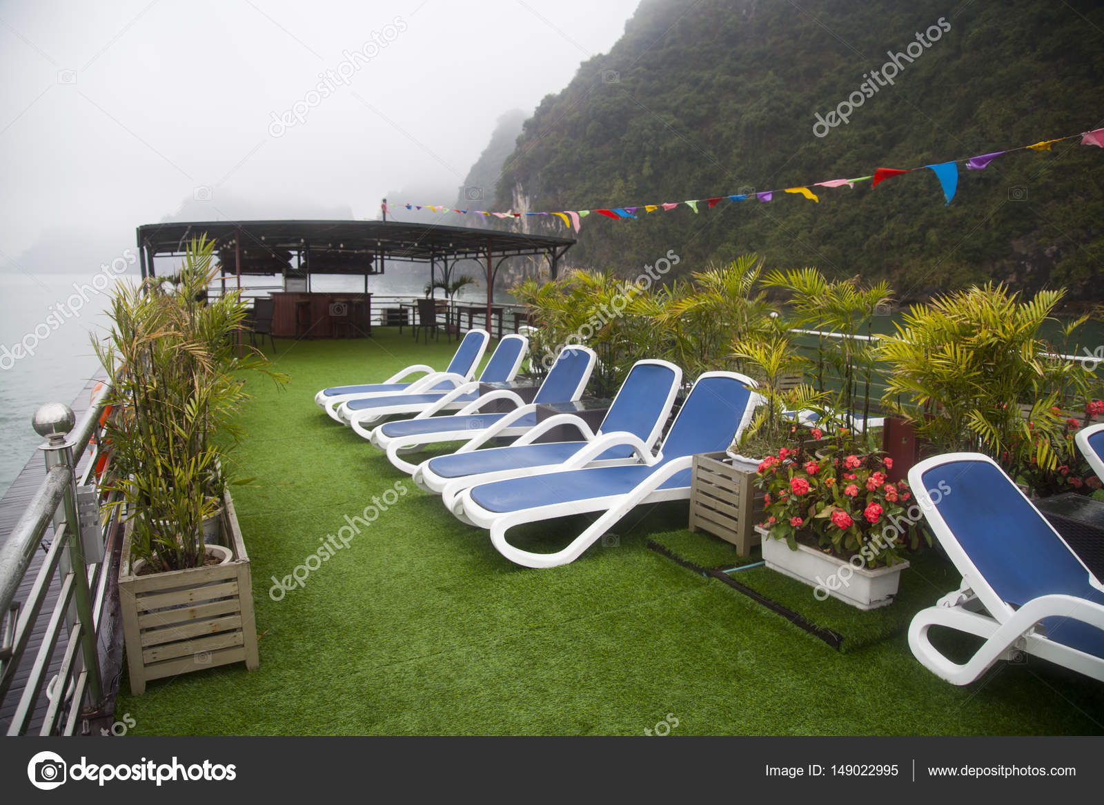 Lounge Chairs On Deck Of Luxury Cruise Ship Stock Photo - Cruise ship pool table