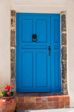 Old blue doors in Greece, Santorini island, Oia village.