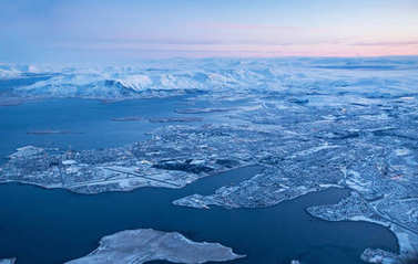 View of Keflavik city in winter through airplane window.