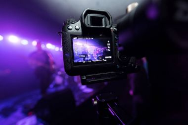 Man capturing the moment on rock concert.