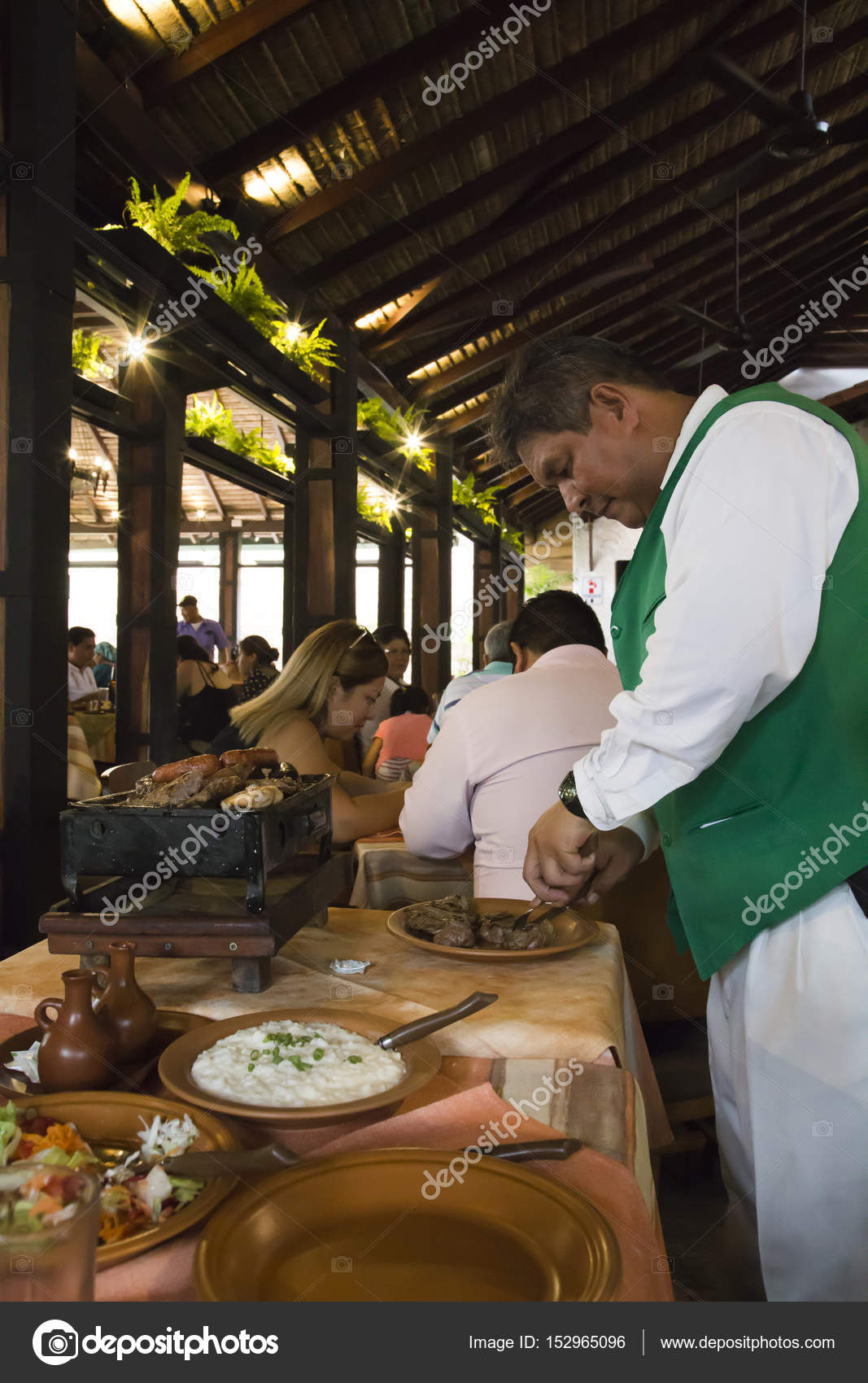 Waiter Preparing Food In A Restaurant In Bolivia Stock Editorial Photo C Jjspring 152965096
