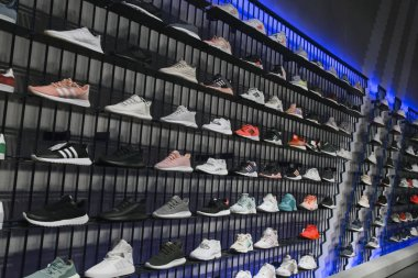 RUSSIA, MOSCOW, 23 MAY 2017 - Interior of Adidas sports retail boutique outlet with sport shoes on shelves